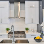 grey and white high gloss cabinets with white countertops (2)